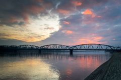 Bridge on the Vistula River lit by the setting sun. Sunset in the city of Torun, illuminates the bridge over the Vistula River, Poland Royalty Free Stock Photo