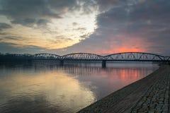 Bridge on the Vistula River lit by the setting sun. Sunset in the city of Torun, illuminates the bridge over the Vistula River, Poland Stock Photography