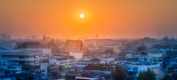 Sunset cityscape with skyscrapers Bangkok. Sunset cityscape with skyscrapers and slum Bangkok, Thailand Royalty Free Stock Photography