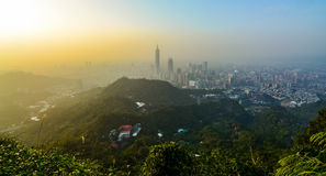 Sunset cityscape of Taipei, Taiwan as seen from a mountaintop overlooking the metropolitan city Stock Photos