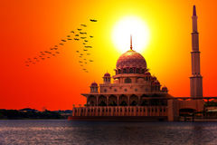 Sunset at the Classic Mosque. Beautiful golden and warm sunset over Putrajaya mosque viewed from the river Stock Images