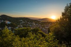 Sunset on a clear sky and mountains stock photography