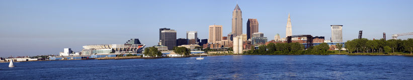 Sunset in Cleveland. Panorama of Cleveland with Browns Stadium, Key and Terminal Towers from Lake Erie stock photos