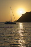 Sunset with cliff and yacht Stock Photo