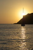 Sunset with cliff and yacht Stock Photography