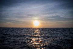 Sunset close to Ko Phi Phi. During a boat trip in the evening. Great view over the ocean and rocks of islands Royalty Free Stock Photography