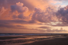 Sunset cloud color. A sunset along the beaches of Lagos, Portugal, with a clouded backlit sky Royalty Free Stock Photos