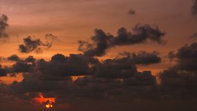 Sunset in the cloud. Timelapse in orange tones stock footage