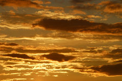 Sunset and cloudds. Sunset and golden cloud in the skies stock photos