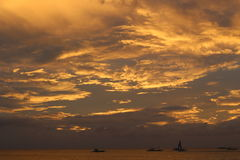 Sunset clouds. Orange sunset cloud floating in the sky, like to the day with a layer of bright sparkling gold plating Stock Photography