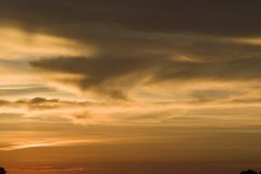 Sunset clouds. Interesting cloud patterns with a setting sun royalty free stock image