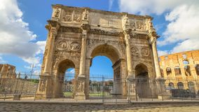 Arch of Constantine Rome. Sunset with clouds   of Arch of Constantine, located between Colosseum and the Arch of Titus on the Roman road, built to celebrate the Stock Photography