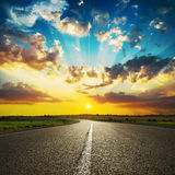 Sunset in clouds and asphalt road Stock Photography