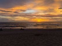 Sunset with clouds of different shapes. People make photos. Bali, Indonesia, Indian ocean Royalty Free Stock Images