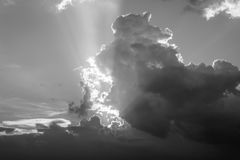 Sunset with clouds in the evening on a weekend. black and white stock photo