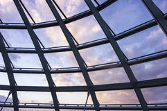 Sunset Clouds Through Glass Roof Stock Photos