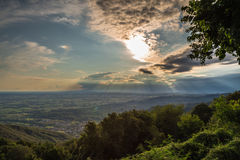 Sunset between clouds on italian countryside Stock Photography