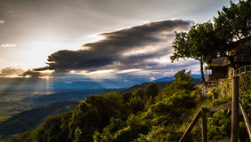 Sunset between clouds on italian countryside Stock Photos
