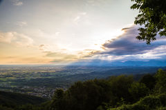 Sunset between clouds on italian countryside Stock Photo