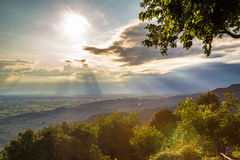 Sunset between clouds on italian countryside Royalty Free Stock Image