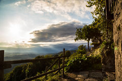 Sunset between clouds on italian countryside Royalty Free Stock Images