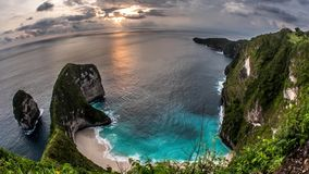 Sunset Clouds Kelingking Beach Nusa Penida Timelapse 4k. Timelapse of a beautiful beach on Nusa Penida, seen from a cliff during a sunset stock video