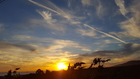 Sunset in clouds Malibu& x27;s Zuma Beach. Malibu is a closely-knit residential community characterized by its carefully preserved rural atmosphere. Malibu`s Royalty Free Stock Photo