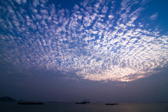 Sunset Clouds Near The Shore Stock Images
