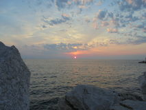Sunset. In clouds over the Adriatic Sea Royalty Free Stock Photo