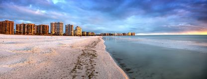 Sunset and clouds over the calm water of Tigertail Beach on Marco Island. Florida royalty free stock photos