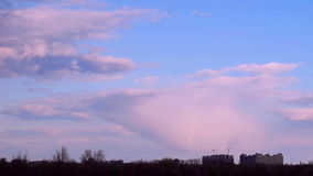 Sunset Clouds over the City. Beautiful Sunset Clouds over the City. Timelapse stock footage