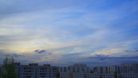 Sunset clouds over the city stock footage