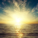 Sunset in clouds over dark sea Royalty Free Stock Photography