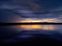 Sunset and clouds over lake. Finland,Lapland. Sunset and clouds over lake. Lapland,Finland royalty free stock images