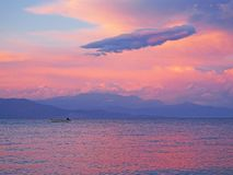 Sunset clouds over Nikolaiika Beach and the Corinthian Gulf in Greece. Beautiful sunset clouds viewed from Nikolaiika Beach on the Corinthian Gulf in Greece on Royalty Free Stock Images