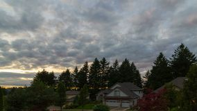 Sunset and clouds over residential suburb homes in Happy Valley Oregon 4k uhd stock video