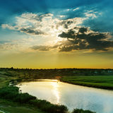 Sunset in clouds over river Royalty Free Stock Photos