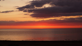 Sunset and red clouds over sea Royalty Free Stock Photography