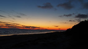 Orange sky over sea at sunset Royalty Free Stock Images
