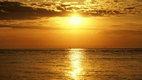 Yaht and sunset over sea Stock Photos