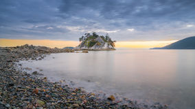 Sunset clouds over at Whyte islet. Whyte islet at Whytecliff park west Vancouver Canada royalty free stock photos