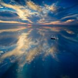 Sunset and clouds reflecting in blue waters