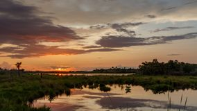Sunset at Merritt Island National Wildlife Refuge, Florida. Sunset with clouds reflecting in a pond at Merritt Island National Wildlife Refuge, Florida, USA stock photo