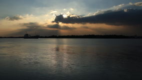 Sunset with clouds and a river flowing stock footage