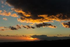 Sunset with clouds and sky. Dramatic sunset with clouds and sky Stock Images