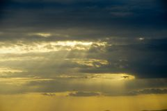 Sunset and clouds. The time in the evening when the sun disappears or daylight fades Royalty Free Stock Image