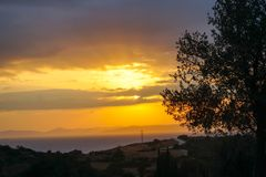 Sunset and clouds. The time in the evening when the sun disappears or daylight fades Stock Photo