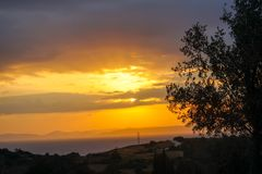 Sunset and clouds. The time in the evening when the sun disappears or daylight fades Royalty Free Stock Photography