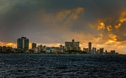 Sunset clouds and view to Malecon promenade street and Vedado di. Strict, Havana, Cuba Royalty Free Stock Image