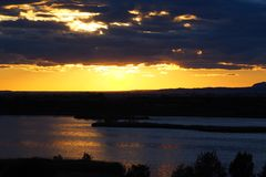A sunset between clouds and water, lerida royalty free stock images